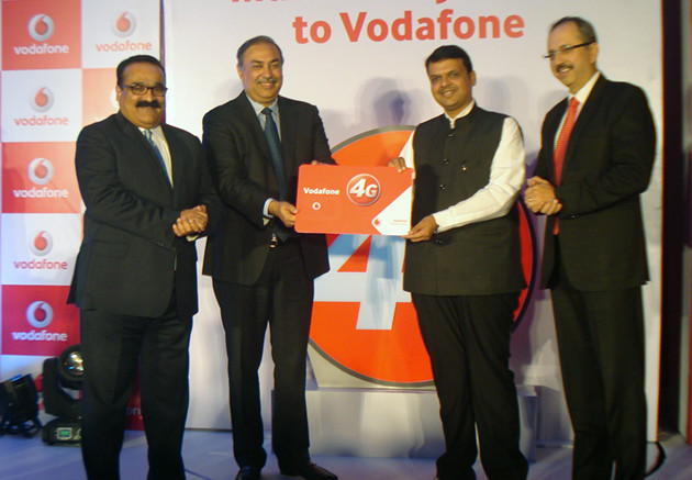 Mumbai : Maharashtra CM Devendra Fadnavis and  Sunil Sood, Vodafone India MD & CEO and  Bhuvanesh Pratap Singh, Operations Director West (L) ad  Ishmeet Singh, Vodafone Business Head, Mumbai circle (R) during the launch of Vodafone 4G services in Mumbai