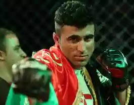 Wali The Warrior Poses after winning the final bout at FCC 12