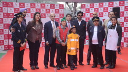 KidZania India .promoters, management & kids with Shah Rukh Khan