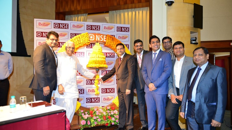 Mr Dindayal Gupta, Chairman, Dollar Industries Ltd; Mr Vinod Kumar Gupta , Managing Director , Dollar Industries Ltd; Mr Binay Kumar Gupta,Jt Managing Director, Dollar Industries Ltd ringing the bell with other company officials - Photo By Sachin Murdeshwar GPN NETWORK