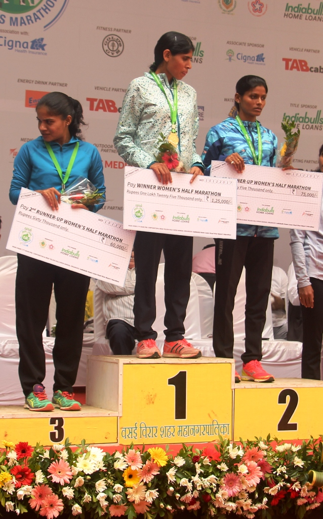 Women half: The proud winners… Swati Gadhave (centre) is flanked by silver medal winner Chinta Yadav (right) and Monika Raut who won the bronze medal in the 7th Indiabulls Home Loans Vasai Virar Mayors Marathon, in association with Cigna TTK, in Virar on Sunday.- Photo By Sachin Murdeshwar GPN / 10.12.17