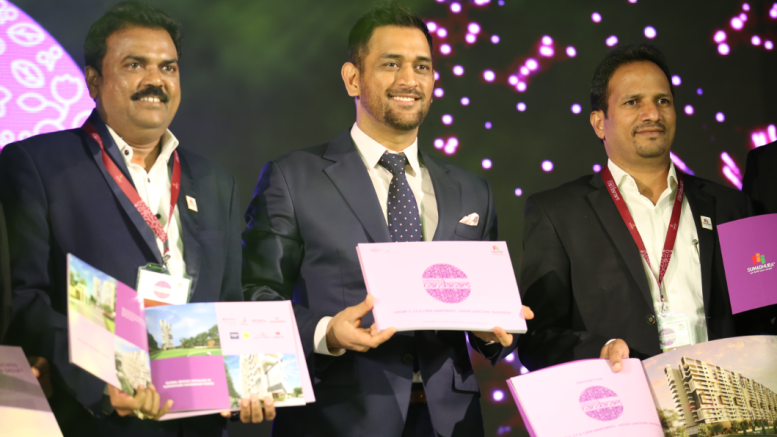 Sumadhura Group's Brand Ambassador MS Dhoni and Mr Madhusudhan G, CMD, Sumadhura Group, unveiling the brochure of Sumadhura Nandanam