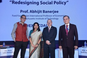 (L-R): Professor Abhijit Banerjee, Ford Foundation International Professor of Economics at Massachusetts Institute of Technology; Ms. Latha Venkatesh, Executive Editor, CNBC TV 18;  Mr David Rasquinha, MD, EXIM Bank and Mr. Debasish Mallick, DMD, EXIM Bank at the EXIM Bank's 34th Commencement Day Annual Lecture - Photo By Sachin Murdeshwar GPN News Network