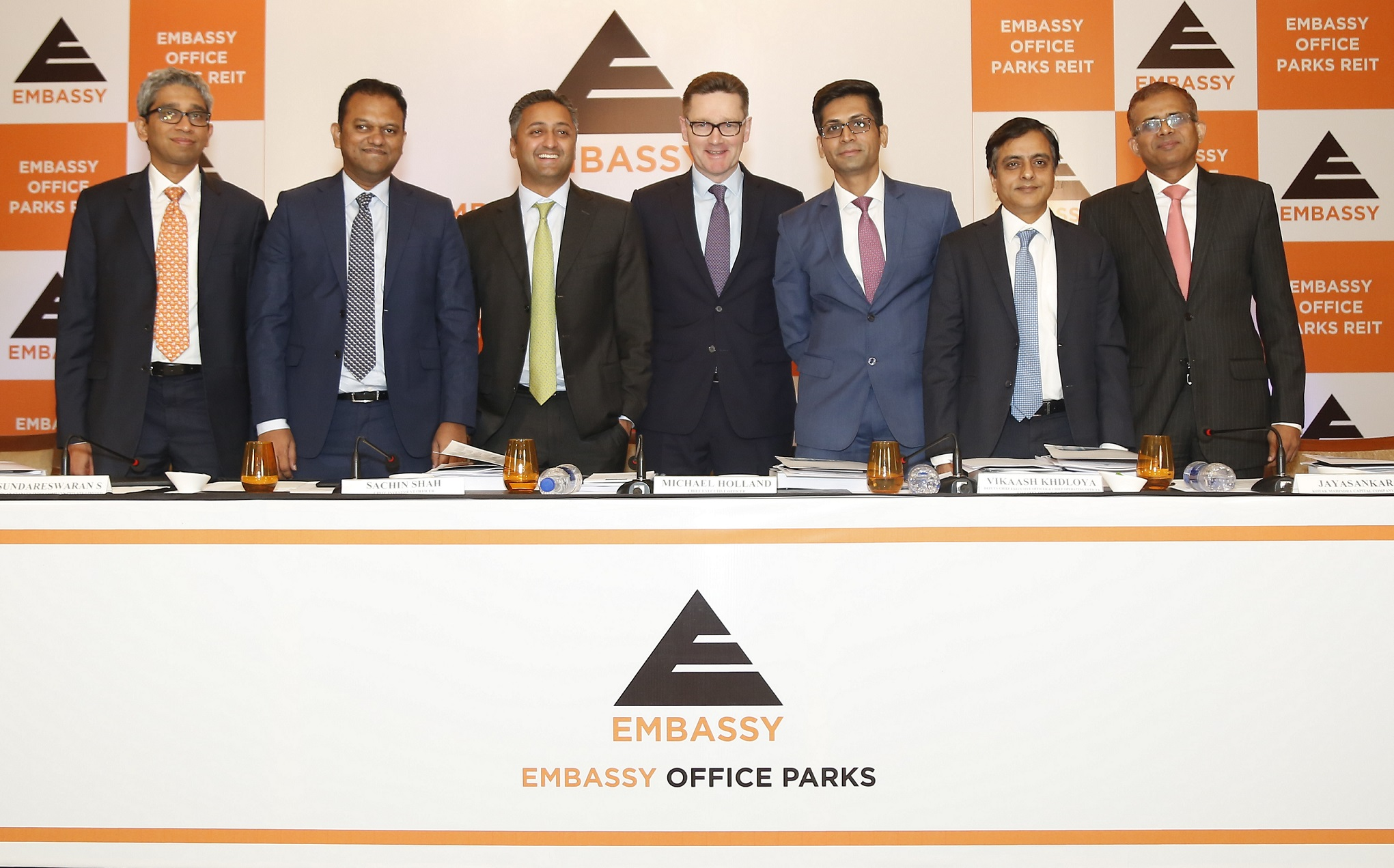 "L to R - Raj Balakrishnan (DSP Merrill Lynch Ltd.), Sundareswaran S. (Morgan Stanley India Company Pvt. Ltd.) Sachin Shah (CIO, Embassy Office Parks Management Services Pvt. Ltd.), Michael Holland (CEO, Embassy Office Parks Management Services Pvt. Ltd.), Vikaash Khdloya (Dy. CEO & COO, Embassy Office Parks Management Services Pvt. Ltd.), V. Jayasankar (Kotak Mahindra Capital Company Ltd.) and Kaustubh Kulkarni (J.P. Morgan India Private Limited) at the press conference to announce Embassy Office Parks REIT (""Embassy REIT"") IPO - Bids open on March 18, 2019 and closes on March 20, 2019"